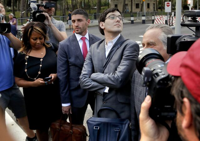 Martin Shkreli stands at an intersection after leaving federal court