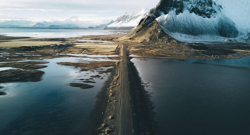 Stokksnes is one of the most iconic places in Iceland with the mountains Vestrahorn and Eytrahorn cradling a beach of black sand, created by never ending waves and winds