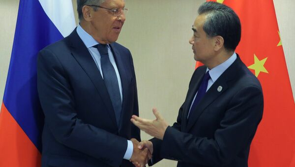 Russian Foreign Minister Sergei Lavrov, left, and Chinese Foreign Minister Wang Yi at their meeting on the sidelines of the ASEAN regional security summit in Manila, Philippines - Sputnik International