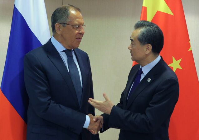 Russian Foreign Minister Sergei Lavrov, left, and Chinese Foreign Minister Wang Yi at their meeting on the sidelines of the ASEAN regional security summit in Manila, Philippines