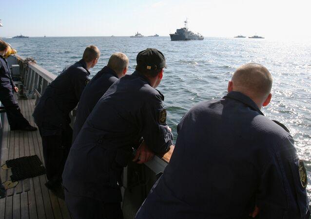 Navy members stand on the deck of a Lithuanian mine-sweeper during the Operation Open Spirit, the latest in a long drive to clear the potentially deably devices from the baltic, off the coast of Klaipeda, in the Baltic Sea, on September 7, 2010