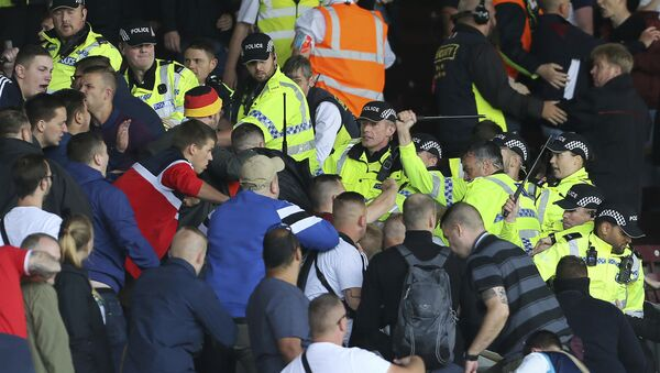 British police confront Hannover soccer club fans during the game against Burnley during their pre-season friendly match at Turf Moor, Burnley, Saturday Aug. 5, 2017. Burnley's pre-season friendly with German side Hannover was abandoned due to crowd trouble. - Sputnik International