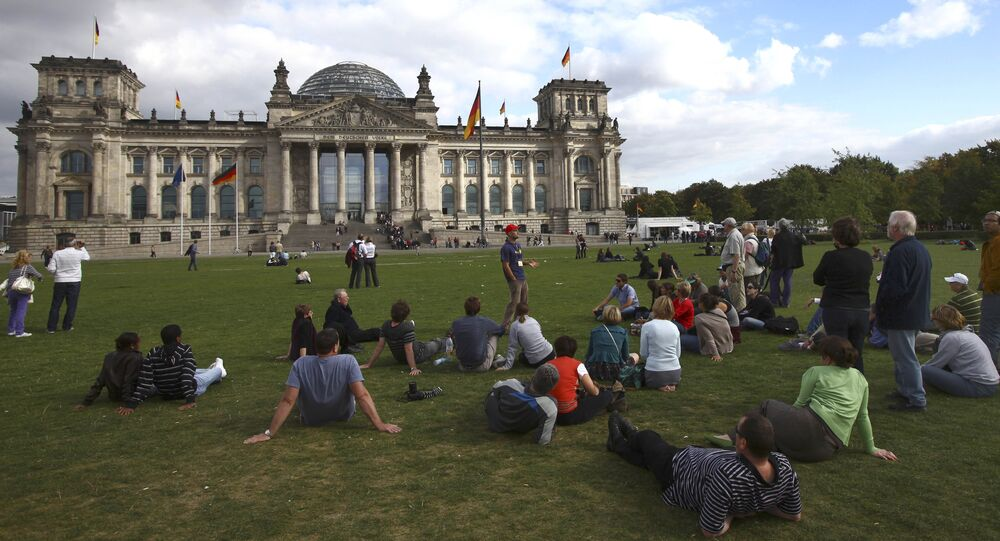 Tourists are seen in front of the Bundestag building in Berlin, Germany, Friday, Sept. 25, 2009.