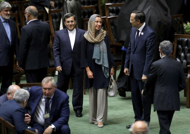 European Union foreign policy chief Federica Mogherini, center, attends the swearing-in ceremony of President Hasan Rouhani for the second term in office, at the parliament in Tehran, Iran, Saturday, Aug. 5, 2017