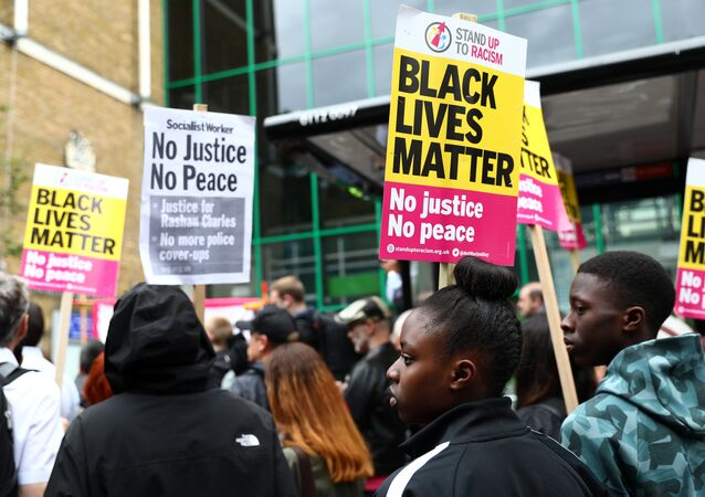 Demonstrators gather at a protest outside Stoke Newington police station over the death of Rashan Charles, London, Britain July 29, 2017.