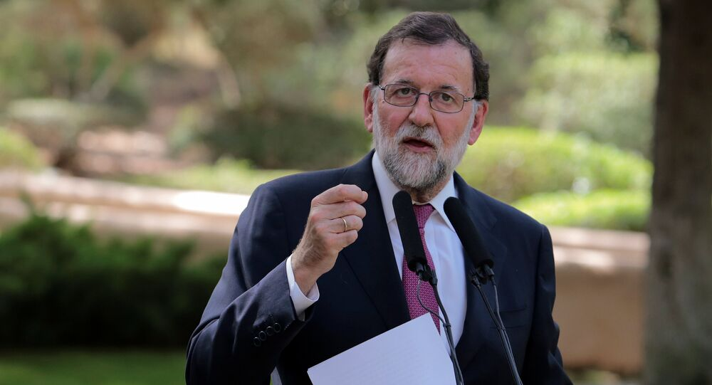 Spanish Prime Minister Mariano Rajoy gestures during a news conference after his traditional summer meeting with King Felipe at Marivent Palace in Palma, on the Spanish island of Mallorca, Spain, August 7, 2017