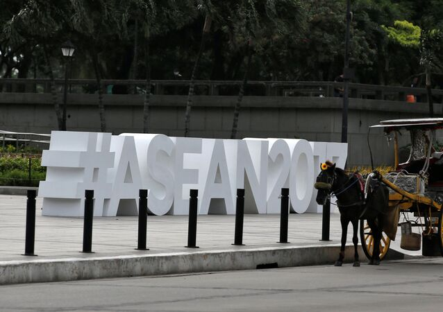 A horse cart driver waits for tourists near the ASEAN logo ahead of the 50th ASEAN Foreign Ministers meeting and in Manila, Philippines August 2, 2017