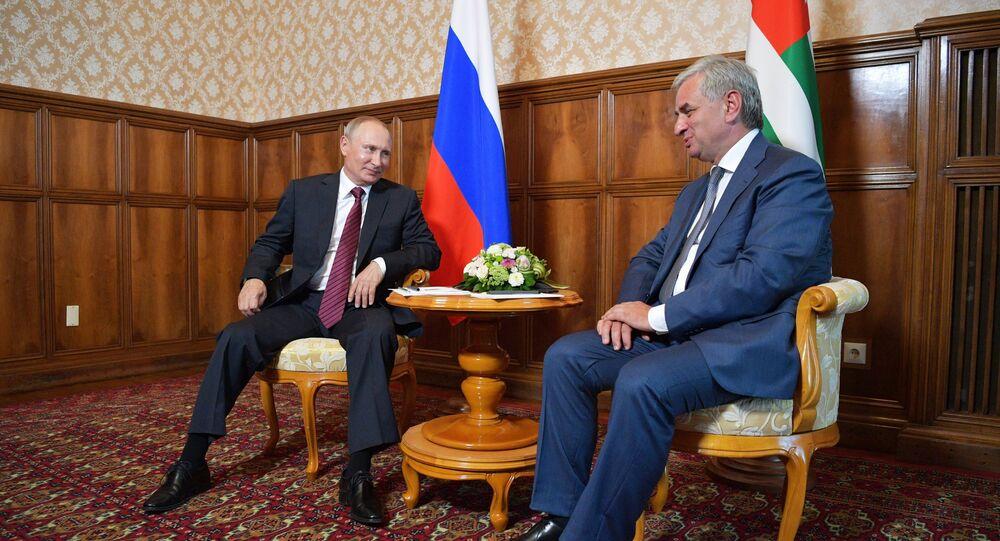 President Vladimir Putin and President of Abkhazia Raul Khadjimba, right, during a meeting