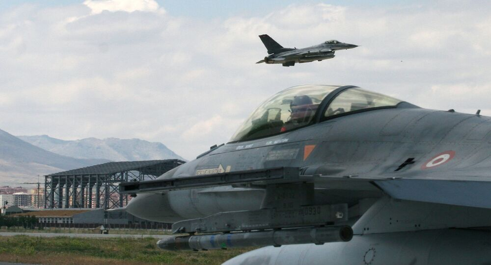 A Turkish F-16 prepares to taxi while another one takes off during Anatolian Eagle exercise at 3rd Main Jet Air Base near the central Anatolian city of Konya, Turkey, Monday, June 15, 2009