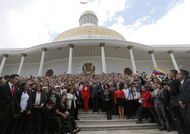 Venezuela's Constituent Assembly poses for an official photo after being sworn in, at Venezuela's National Assembly in Caracas, Venezuela, Friday, Aug. 4, 2017. Venezuelan President Nicolas Maduro is heading toward a showdown with his political foes, after seating a loyalist assembly that will rewrite the country's constitution and hold powers that override all other government branches.