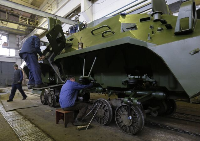 Workers in a tank factory are assembling the armored vehicles in Kiev, Ukraine, Wednesday, Dec. 23, 2015