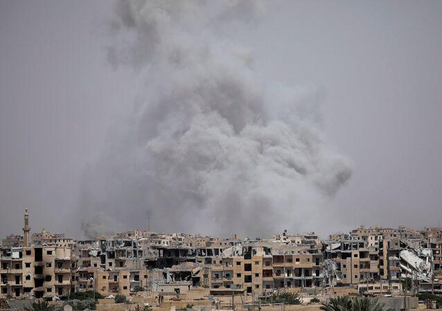 Smoke rises from Raqqa, Syria July 28, 2017