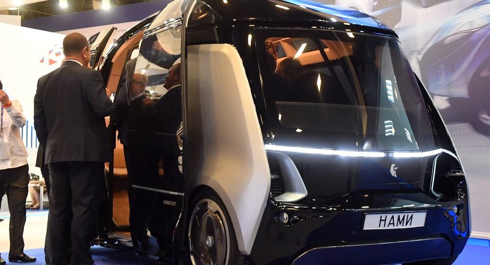 A KAMAZ 'Shuttle' self-driving bus at KAMAZ's stand at the 2017 St. Petersburg International Economic Forum. File photo