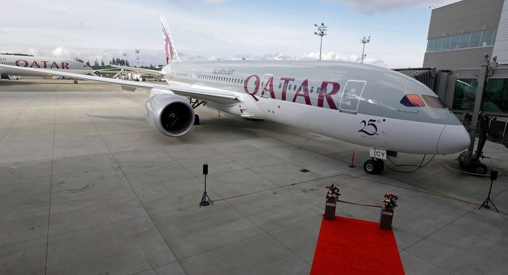 In this Nov. 4, 2015 file photo, a Boeing 787 airplane purchased by Qatar Airways is shown during a delivery ceremony in Everett, Washington.