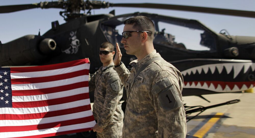 In this March 16, 2011, file photo Army Staff Sgt. Christopher Seeman, right, of Kalispell, Mont., takes the oath of re-enlistment as Spc. Brian Martinez, center, of Aurora, Ill., holds up a American flag in front of an Apache helicopter during a ceremony at Camp Taji, north of Baghdad, Iraq.
