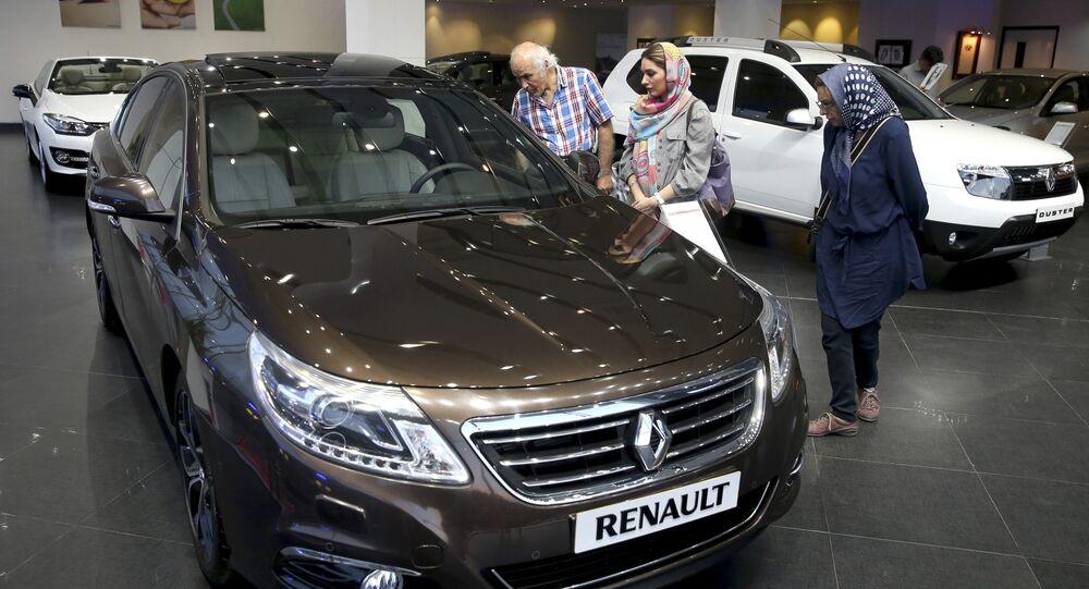 In this Thursday, July 16, 2015 photo, Iranians look at a Renault sedan at a dealership in northern Tehran, Iran