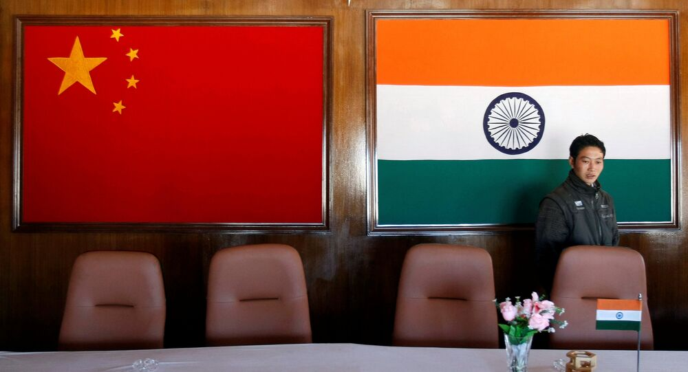 A man walks inside a conference room used for meetings between military commanders of China and India, at the Indian side of the Indo-China border at Bumla, in the northeastern Indian state of Arunachal Pradesh, November 11, 2009
