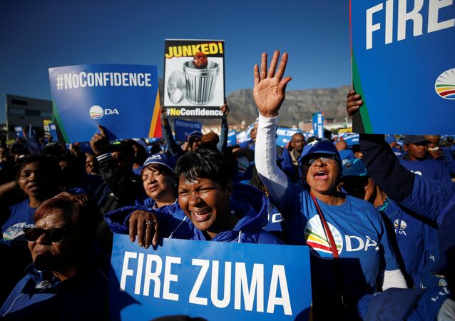 Opposition supporters march ahead of the vote of no confidence against President Jacob Zuma in Cape Town, South Africa, August 8, 2017