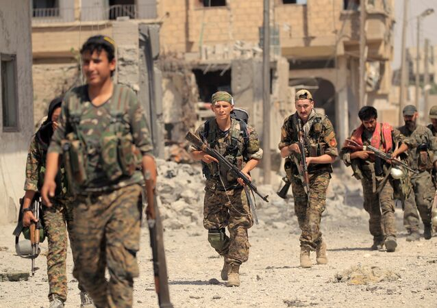 Members of the Syrian Democratic Forces advance toward Islamic State positions in Seif Al Dawla district of Raqqa, Syria August 9, 2017