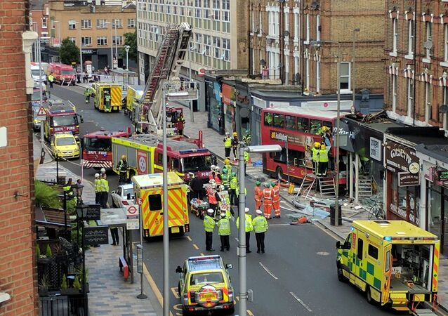 Emergency services attend the scene of a bus crash in Lavender Hill, London August 10, 2017 in this picture obtained on social media