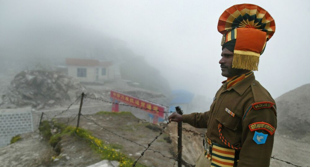 In this photograph an Indian soldier stands guard at the ancient Nathu La border crossing between India and China