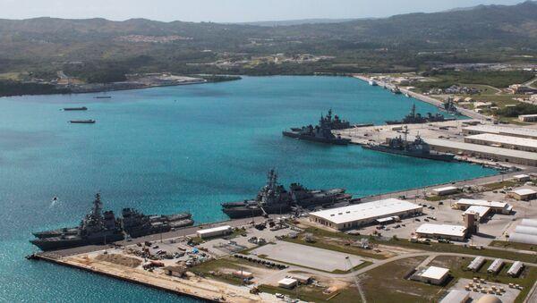 Navy vessels are moored in port at the U.S. Naval Base Guam at Apra Harbor, Guam March 5, 2016 - Sputnik International