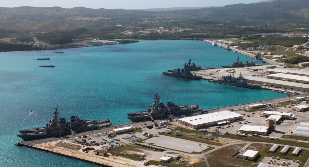 Navy vessels are moored in port at the US Naval Base Guam at Apra Harbor, Guam March 5, 2016