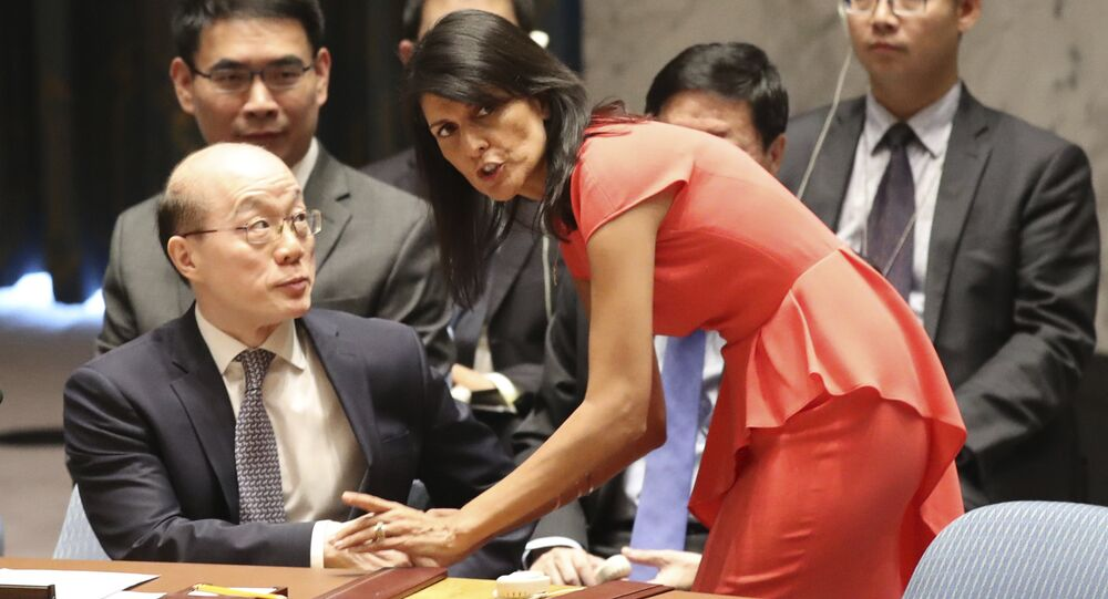 American Ambassador to the United Nations Nikki Haley, right, speaks to Chinese Ambassador to the United Nations Liu Jieyi before a Security Council vote on a new sanctions resolution that would increase economic pressure on North Korea to return to negotiations on its missile program, Saturday, Aug. 5, 2017 at U.N. headquarters