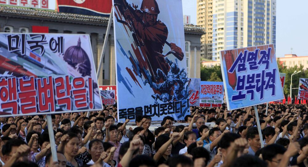 Tens of thousands of North Koreans gathered for a rally at Kim Il Sung Square carrying placards and propaganda slogans as a show of support for their rejection of the United Nations' latest round of sanctions on Wednesday Aug. 9, 2017, in Pyongyang, North Korea
