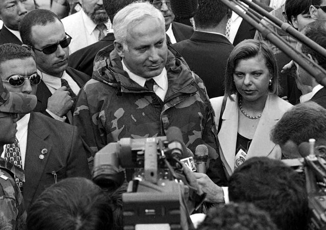 Israeli Prime Minister Benjamin Netanyahu and his wife Sara Netanyahu speak to reporters after visiting the Demilitarized Zone separating South Korea from its communist rival, North Korea, Thursday, Aug. 28, 1997.
