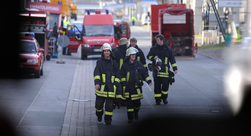 (File) Fire brigades work at the chemical industrial park in Marl, western Germany, on March 31, 2012