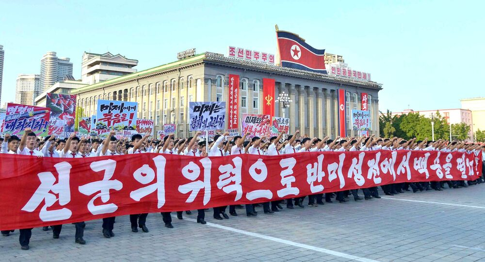People participate in a Pyongyang city mass rally held at Kim Il Sung Square on August 9, 2017, to fully support the statement of the Democratic People's Republic of Korea (DPRK) government in this photo released on August 10, 2017 by North Korea's Korean Central News Agency (KCNA) in Pyongyang
