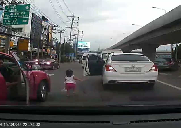 Bangkok Driver Nearly Crushes Toddler After Child Tumbles From Car