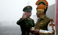 Chinese soldier (L) gesturing next to an Indian soldier at the Nathu La border crossing between India and China in India's northeastern Sikkim state. (File)