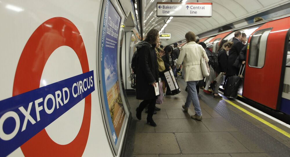 People board an underground Tube train at Oxford Circus underground station in London. (File)