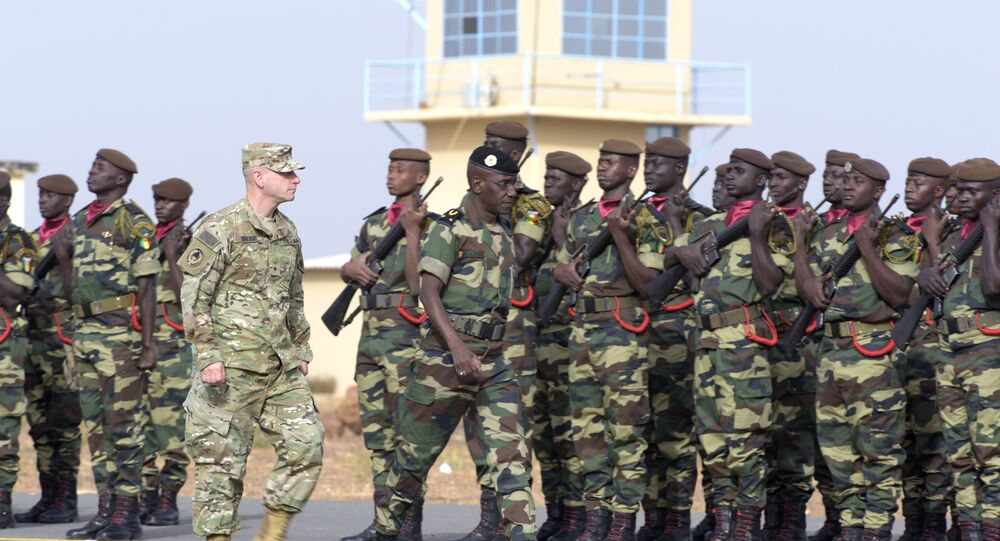 Senegal's Army General Amadou Kane (C) and US Army General Donald Bolduc (L) review the troops during the inauguration of a military base in Thies, 70 km from Dakar. (File)