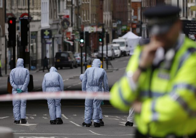 Forensic police investigate an area in the London Bridge area of London, Monday, June 5, 2017.