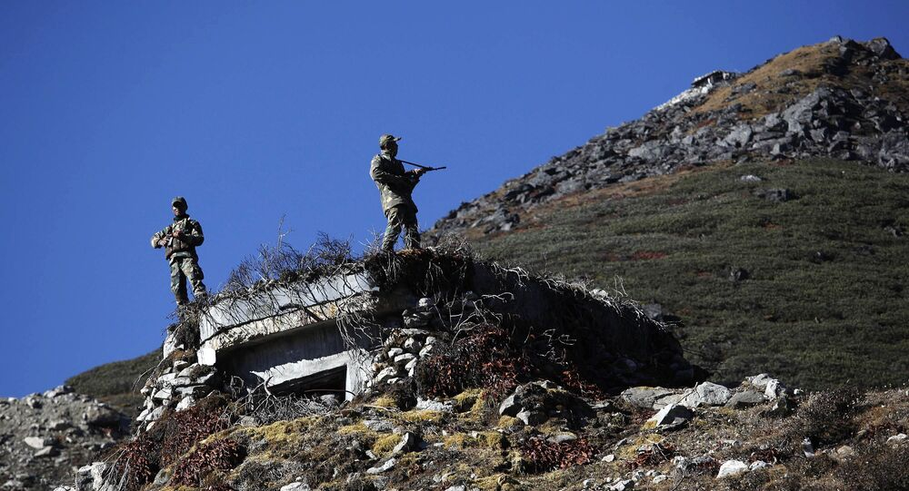 Indian army soldiers keep watch at the Indo China border in Bumla at an altitude of 15,700 feet (4,700 meters) above sea level in Arunachal Pradesh, India. (File)