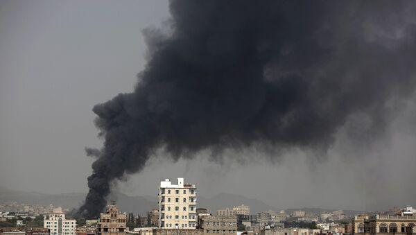 Smoke rises after Saudi-led airstrikes hit a food factory in Sanaa, Yemen. (File) - Sputnik International