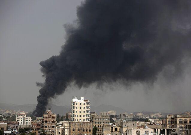 Smoke rises after Saudi-led airstrikes hit a food factory in Sanaa, Yemen. (File)