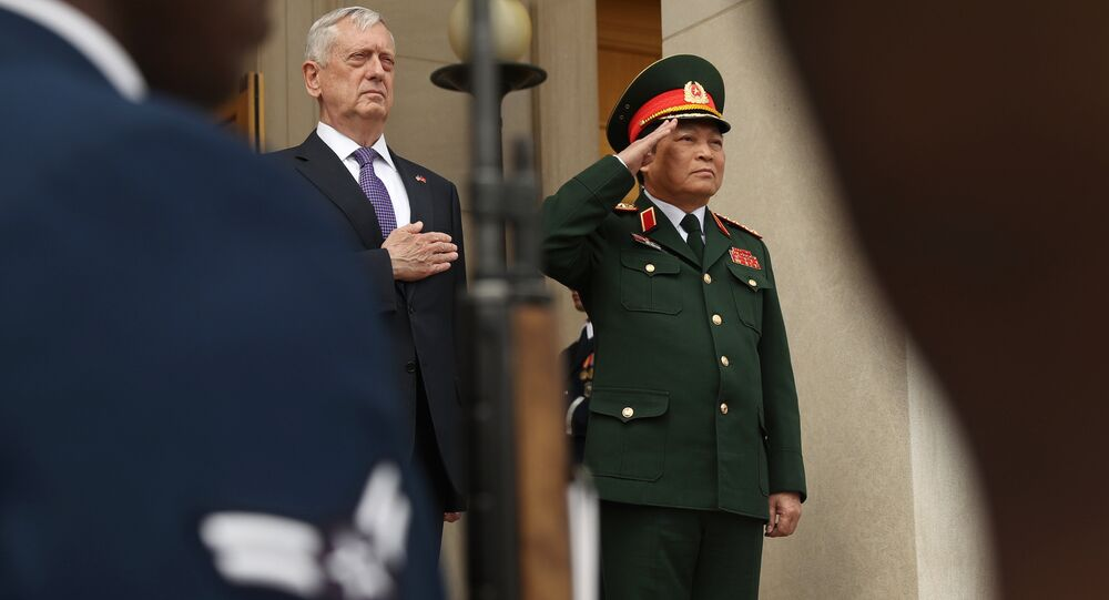 Defense Secretary Jim Mattis and Vietnam Defense Minister Gen. Ngo Xuan Lich participate in an enhanced honor cordon at the Pentagon