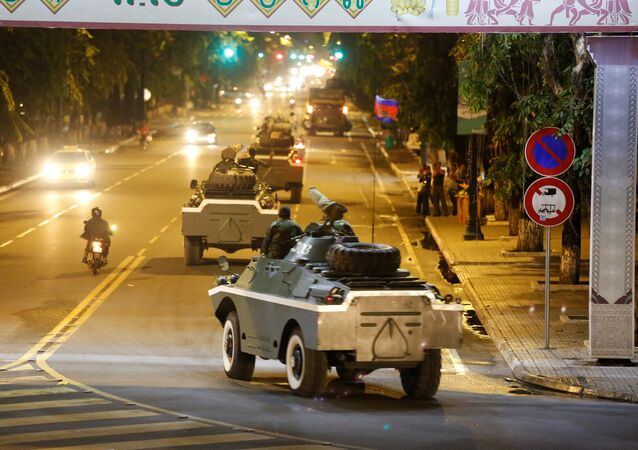 Army vehicles are seen along a street in Phnom Penh, Cambodia