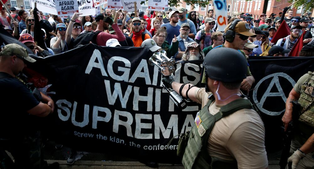 Members of white nationalists are met by a group of counter-protesters in Charlottesville, Virginia, U.S