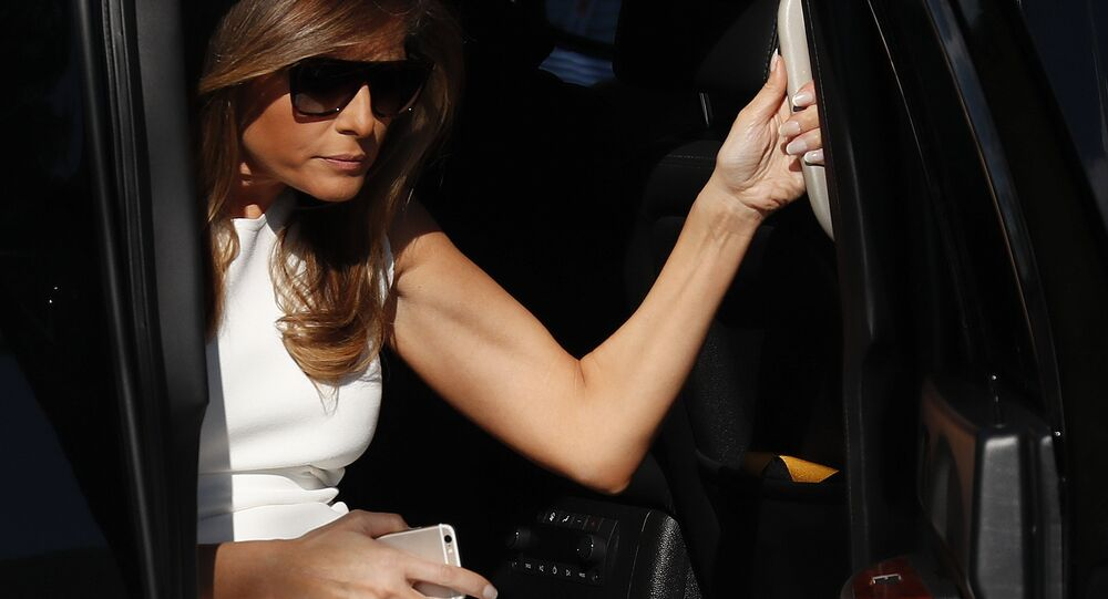 First lady Melania Trump steps from her motorcade vehicle