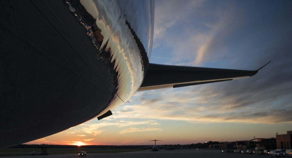 The tail of Air Force One is seen on the tarmac as the sun sets