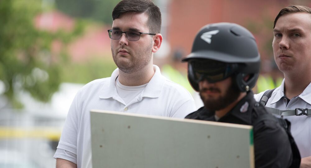 James Alex Fields Jr., (L) is seen attending the Unite the Right rally in Emancipation Park before being arrested by police and charged with charged with one count of second degree murder, three counts of malicious wounding and one count of failing to stop at an accident that resulted in a death after police say he drove a car into a crowd of counter-protesters later in the afternoon in Charlottesville, Virginia, U.S