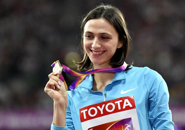 Women's high jump gold medalist Russia's Maria Lasitskene holds her medal on the podium at the World Athletics Championships in London Saturday, Aug. 12, 2017.