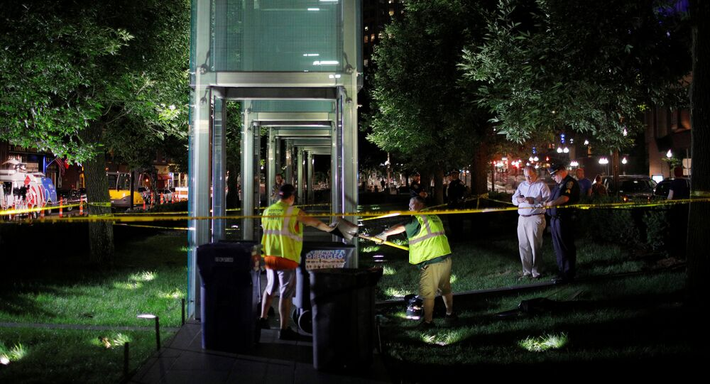 Workers clean up broken glass after the Holocaust Memorial was vandalized in Boston, Massachusetts, U.S., August 14, 2017