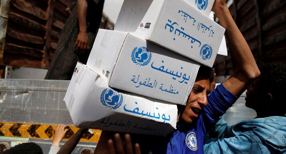 A volunteer carries hygiene kits provided by UNICEF, amid a cholera outbreak, in Sanaa, Yemen, May 24, 2017