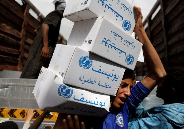 A volunteer carries hygiene kits provided by UNICEF, amid a cholera outbreak, in Sanaa, Yemen, May 24, 2017